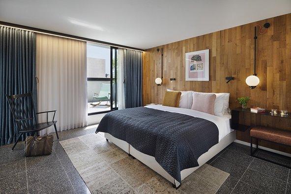 חדר מזמין במלון פבריק | צילום: אסף פינצ'וק