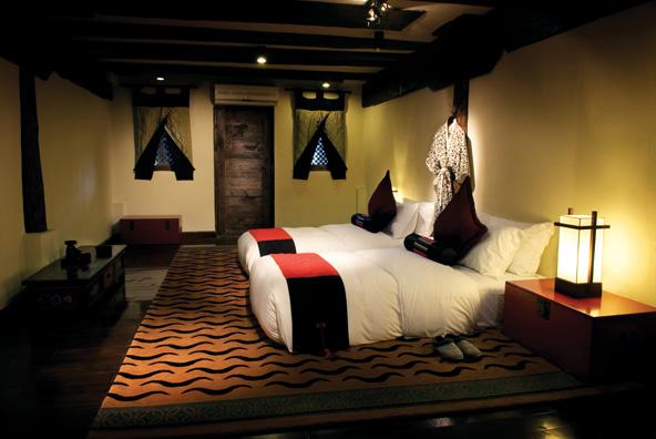 חדר זוגי ב-מלון Banyan Tree Ringha. עיצוב מסורתי, בלי לוותר על פינוקים ונוחות עכשווית