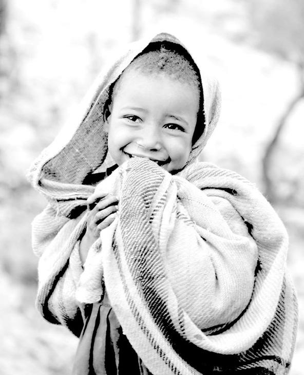 החיוך אומר הכל. ילד מקומי בהרי הסימיאן | צילום: גלעד רוזנברג
