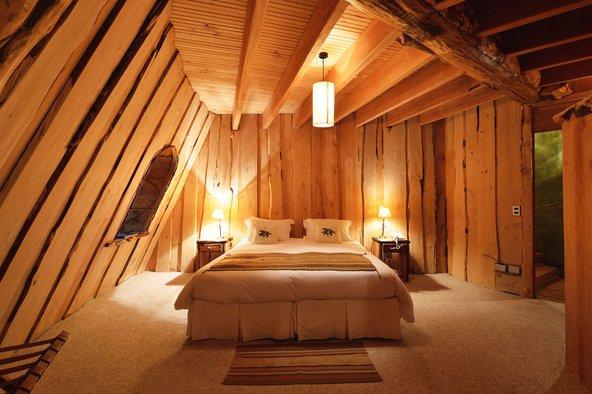 מלון Montana Magica. האווירה הקסומה נמשכת גם בתוך החדרים   צילום: Huilo Huilo Biological Reserve