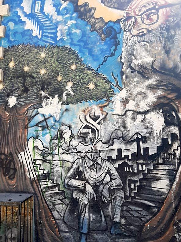 ציורי קיר וגרפיטי בשכונת נחלאות. אמנות הרחוב הירושלמית שונה מאוד מזאת בתל אביב